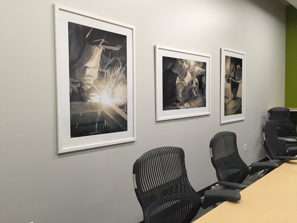 Festival Foods used enlarged photographs that feature the building in various stages of completion on wall in a conference room