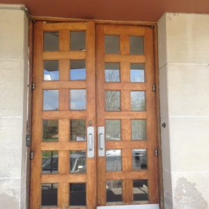 Wood Doors with small windows and kickplates